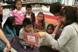 Woman Reading to Children